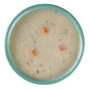 A photo of creamy chicken and wild rice soup with carrots poking out the top, seasoned with black pepper and served in a light turquoise bowl.
